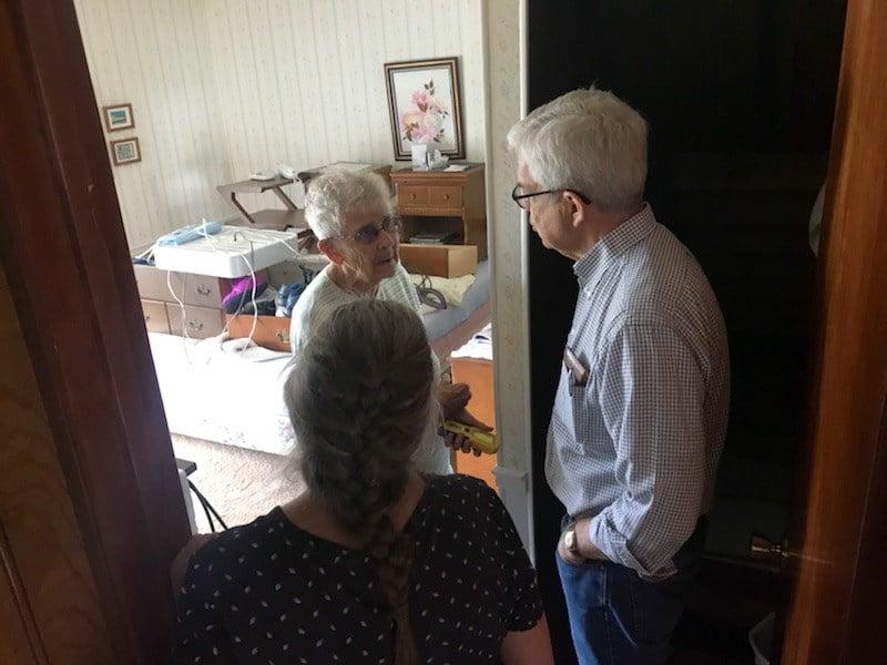 Lt. Gov. Mike Cooney speaks to Dorthy Opheim